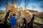 Students building a wood-based structure at Silo City