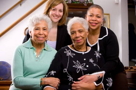 UB researcher Heather Ochs-Balcom with the family of Veronica Meadows-Ray.