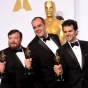 "Tom Curley, on the left, wearing a tux and holding an Oscar statue, along with Crain Mann and Ben Wilkins, who all won the Oscar for sound mixing in the film ""Whiplash."""
