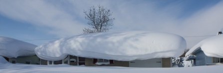 house roof covered in snow