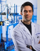 Parham Rohani standing in the lab, poses for a picture.