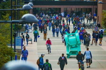 photo of a bunch of students walking along the academic spine on UB's North Campus.
