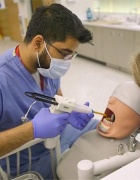 Dental student working on patient simulator.
