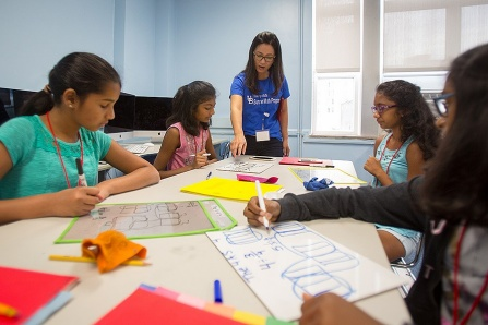 Ji-Won Son, the program director for the Summer Math Program interacts with students during an activity session on July 20, 2017. The program was held at the Buffalo Academy of Science in downtown Buffalo