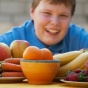 obese child with healthy food.