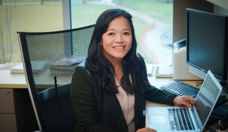 Juliane Nguyen sitting at a desk.