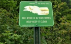 A sign that discusses keeping the river clean.