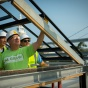 UB architecture professor Kenneth MacKay inspects a beam on the roof of the GRoW Home.