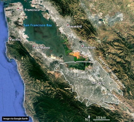 A satellite image of an area of California, with a white line delineating the boundaries of the Santa Clara Valley aquifer.