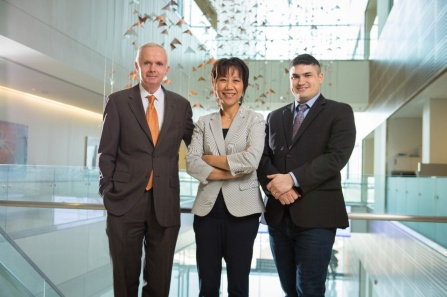 Jeff Harvey, Hui Meng and Vincent Tutino standing in a modern building.