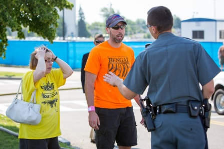 Photo of a police officer speaking with two individuals during a training drill at UB.