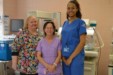 UB nursing professor Deborah Raines, Sisters Hospital nurse Tracey Zimmerman and nursing student Stephanie Rodriguez in the maternal-newborn unit at Sisters of Charity Hospital.